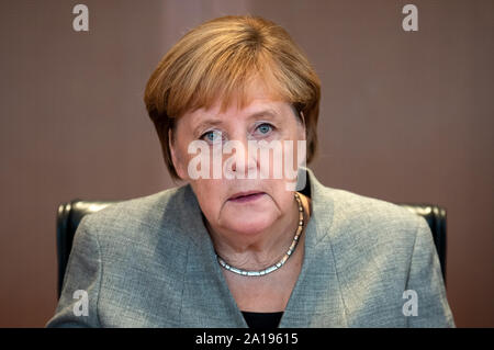 Berlin, Germany. 25th Sep, 2019. Chancellor Angela Merkel (CDU) sits in the Chancellor's Office at the beginning of the cabinet meeting. After the coalition leaders and the climate cabinet, the entire cabinet is now dealing with the cornerstones of climate protection. Credit: Bernd von Jutrczenka/dpa/Alamy Live News - Stock Photo