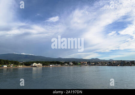 view form nearby pier on Iho Tewoo Beach and lanscape of jeju island with scenic cloudscape - Stock Photo
