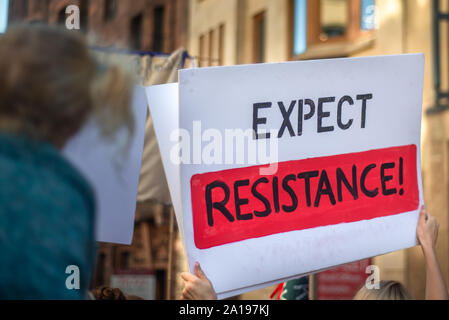 Expect Resistance Banner Held Up at a Climate Protest March in Glasgow Scotland - Stock Photo