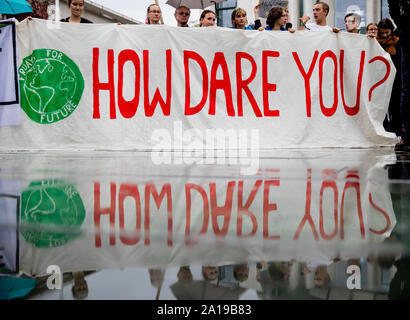 Berlin, Germany. 25th Sep, 2019. 'How dare you?' (How dare you?) can be read on a banner in front of the Federal Chancellery at a rally of Fridays for Future and the non-governmental organisation Campact against the climate policy of the Federal Government. Credit: Christoph Soeder/dpa/Alamy Live News - Stock Photo