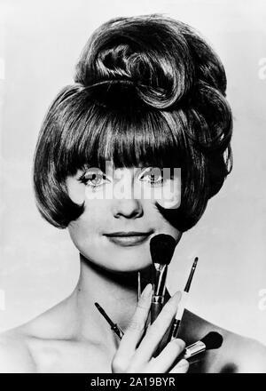 model, make-up brushes, 1960s - Stock Photo
