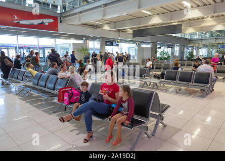Dubrovnik airport - a family with children sitting in the departure lounge in the interior of the terminal, Dubrovnik local Airport Croatia Europe - Stock Photo