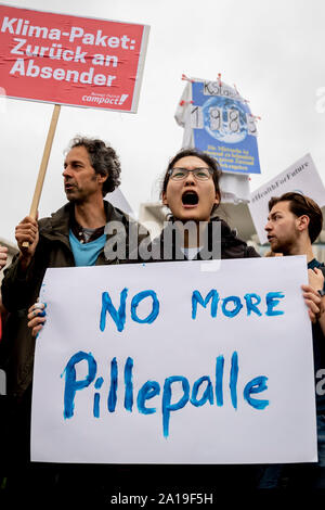 Berlin, Germany. 25th Sep, 2019. 'No more Pillepalle' is on a poster in front of the Federal Chancellery at a demonstration by Fridays for Future and the non-governmental organisation Campact against the climate policy of the Federal Government. Credit: Christoph Soeder/dpa/Alamy Live News - Stock Photo