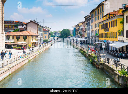 Milan, Italy - May 10, 2019: View of the Naviglio Grande water canal on a sunny day. This district is famous for its restaurants, cafes, pubs and nigh Stock Photo
