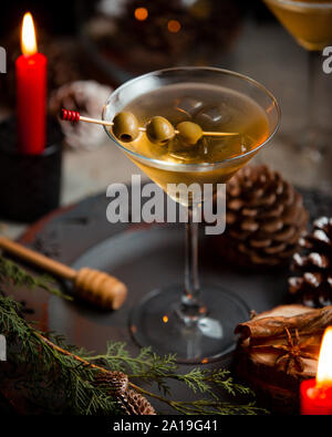 Cooling martini with olives on plate - Stock Photo