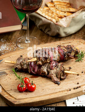 Traditional kebab on the wooden board - Stock Photo