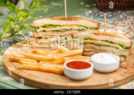 Classic chicken club sendwich with french fries - Stock Photo