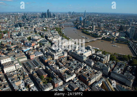 An aerial view to the River Thames across Embankment and the Shard.