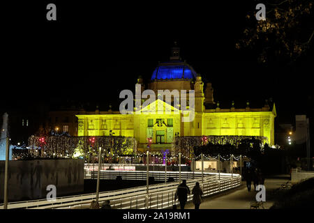Zagreb pavilion by night with skating ring in Christmas time in front - Stock Photo