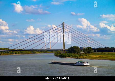 the Niederrhein bridge across the river Rhine, cargo vessel, Wesel, Germany.  die Niederrheinbruecke ueber den Rhein, Frachtschiff, Wesel, Deutschland - Stock Photo