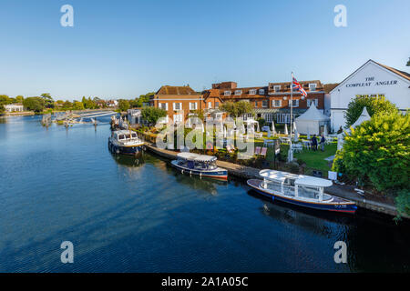 Riverside view of The Compleat Angler and moored boats in Marlow, a town on the River Thames, Wycombe district of Buckinghamshire, southeast England - Stock Photo