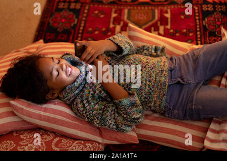 Girl at home at Christmas time - Stock Photo