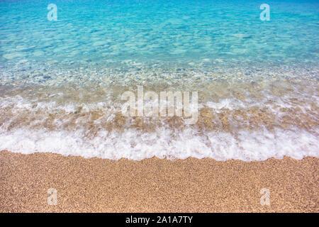 Close-up photo of beautiful beach with crystal clear turquoise water, Gialos beach on west coast of Lefkada island, Greece. - Stock Photo