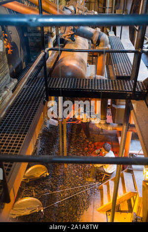Re-created Engine room and furnace being fed coal by mannequin model figures; engine of the SS Great Britain, Brunel's steam powered ship in dry dock in in Bristol. UK England (109) - Stock Photo