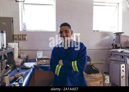 Portrait of a young man in a clothing factory