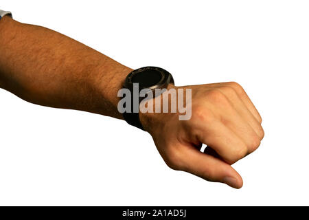 Young man wearing a smartwatch - Stock Photo