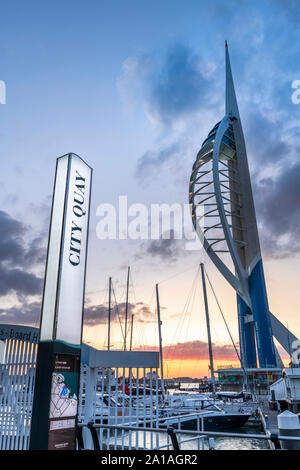 Portsmouth, Hampshire, England. After a hot and humid day on the Hampshire coast, the lights come on at Gunwharf Quays as the sun sets over Portsmouth - Stock Photo