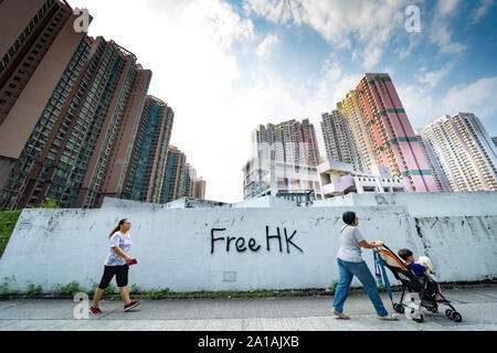 Pro democracy and anti extradition law protest graffiti on wall near housing estates in Ma On Shan in Hong Kong - Stock Photo