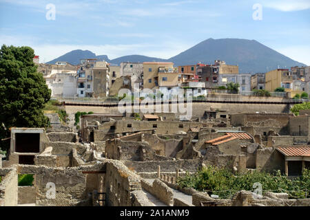 The Ancient City of Herculaneum, Campania, Italy with at the background the modern city. The old city is an UNESCO World Heritage Site - Stock Photo