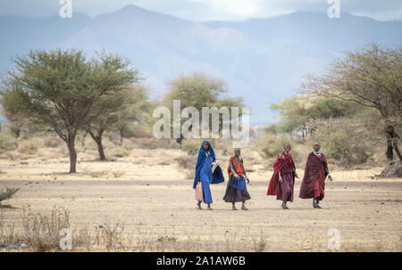 Arusha, Tanzania, 10th September 2019:  maasai ladies in a landscape of northern Tanzania - Stock Photo