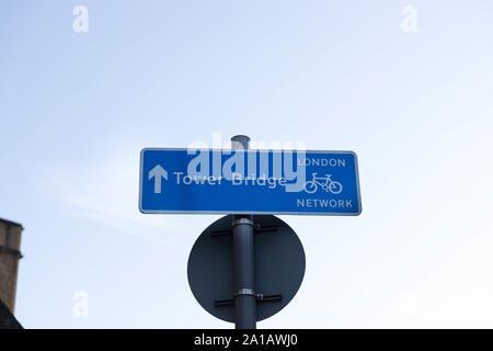 Bike lane pannel information to the tower bridge - Stock Photo