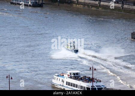 Police boat on the thames london - Stock Photo