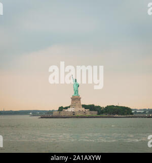 The statue of Liberty from the distance,  in New York City - Stock Photo