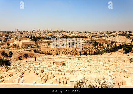 View of Jerusalem old city, Temple Mount and the ancient Jewish cemetery from the Mount of Olives, Israel - Stock Photo