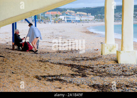 Weymouth. 25th September 2019. UK Weather. A woman enjoys a swim in sunny Weymouth, as the rain holds off for a few hours. credit: stuart fretwell/Alamy Live News