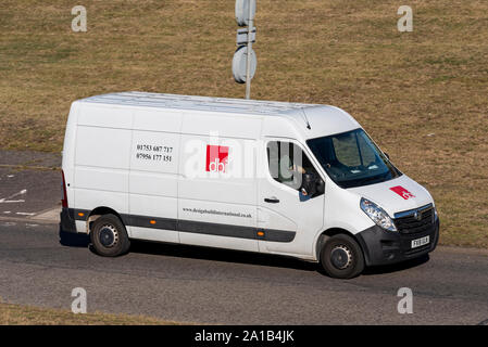 DBI Design Build International vehicle van driving on the road near Heathrow, London, UK. General building & construction company. Space for copy - Stock Photo