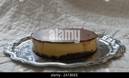 A very delicious homemade pumpkin cake covered with chocolate on a tray. With copy space for text - Stock Photo