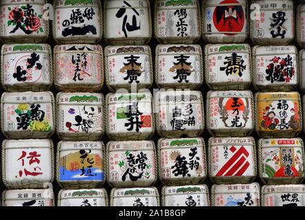 Barrels of sake wrapped in straw, Meiji shrine, tokyo, japan - Stock Photo