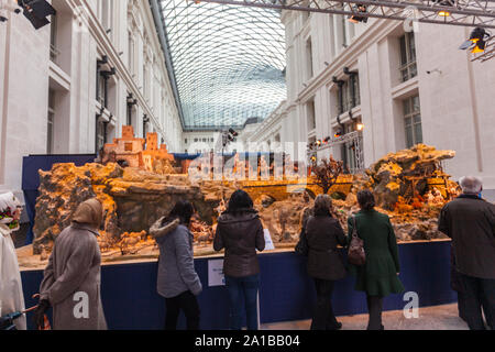 People visiting the Nativity scene, Belén in Spanish, depicting of the birth of Jesus placed in the Madrid Town Hall during 2011 Christmas. Spain - Stock Photo