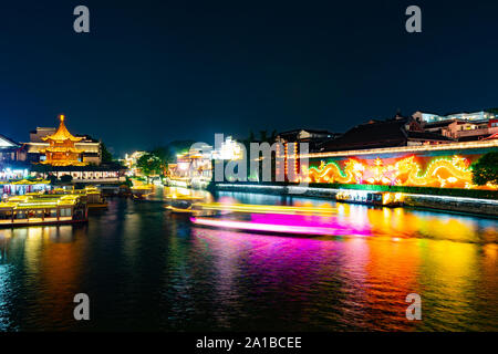 Nanjing Qinhuai River Popular Sightseeing Spot for Visitors Cruising with Ships at Late Night - Stock Photo
