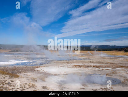 Hot springs steaming, Midway Geyser Basin, Yellowstone National Park, Wyoming, USA Stock Photo