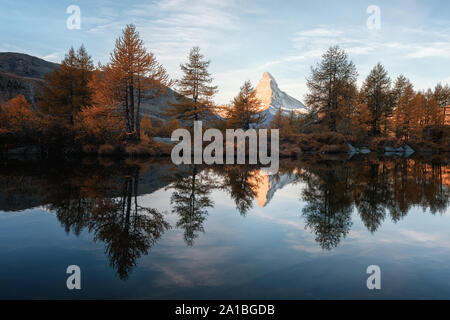 Incredible colorful sunset on Grindjisee lake with Matterhorn Cervino peak in Swiss Alps. Zermatt resort location, Switzerland. Landscape photography - Stock Photo
