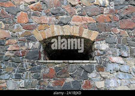 Opening in the wall in the sea fortress of Suomenlinna, near Helsinki, Finland. - Stock Photo