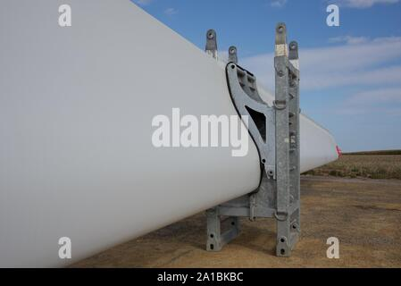 Wind turbine blades poised for distribution to new wind turbine sites throughout the region of northern France - Stock Photo