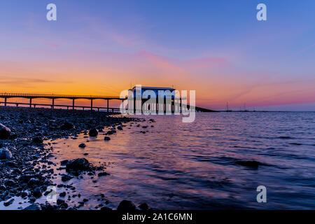 UK Roa Island, Cumbria. Sunrise from Roa Island, Rampside, Barrow-In-Furness, Cumbria. View towards Roa Island Lifeboat Station. - Stock Photo