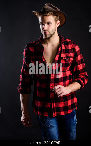 gold rush. wild west rodeo. Handsome man in hat. western cowboy portrait. cowboy in country side. Western. man checkered shirt on ranch. Vintage style man. Wild West retro cowboy. - Stock Photo