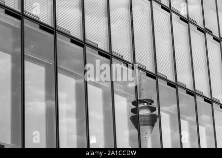 Black and white tone, exterior view of reflecting Rheinturm, Rhine tower, on grid frame facade structure with mirror glass panel. - Stock Photo