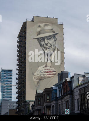 A mural of Leonard Cohen on a building near downtown Montreal, Canada. Notice the red emminating from his heart. - Stock Photo