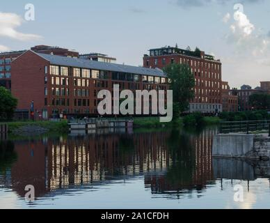 The still waters of the Lachine Canal reflect the Parc St. Patrick condos. - Stock Photo