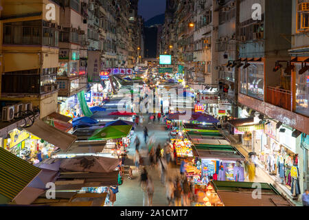 Night view of traditional street market on Fa Yuen Street in Mongkok , Kowloon, Hong Kong. - Stock Photo