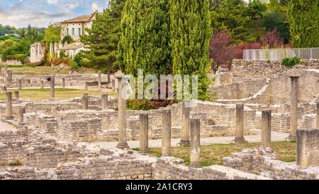 Ancient Roman ruins are situated in the center of the French town of Vaison-la-romaine, surrounded by modern buildings, and are now a tourist site. - Stock Photo