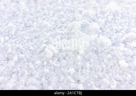 Macro closeup view on texture of Bonneville salt flats with wet salt on ground abstract - Stock Photo