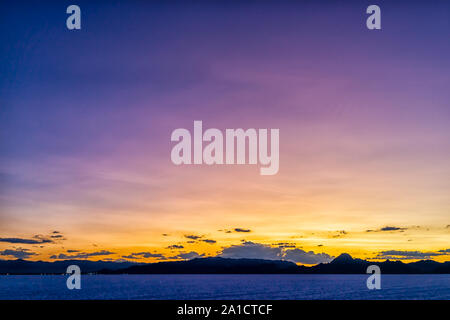 Wide Angle view of White Bonneville Salt Flats near Salt Lake City, Utah at twilight after sunset with purple and blue sky and horizon - Stock Photo