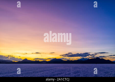 Wide Angle view of Bonneville Salt Flats near Salt Lake City, Utah at twilight after sunset with purple and blue sky and horizon - Stock Photo