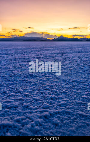Vertical view of White Bonneville Salt Flats texture near Salt Lake City, Utah at twilight after sunset with purple and blue sky and horizon - Stock Photo