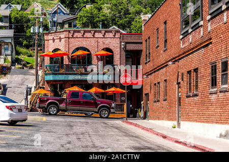 Park City, USA - July 25, 2019: Ski resort town in Utah during summer with downtown historic brick buildings street road and cars - Stock Photo